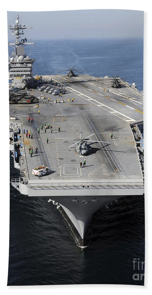 Humanitarian Relief Hand Towel featuring the photograph Aircraft Carrier Uss Carl Vinson by Stocktrek Images