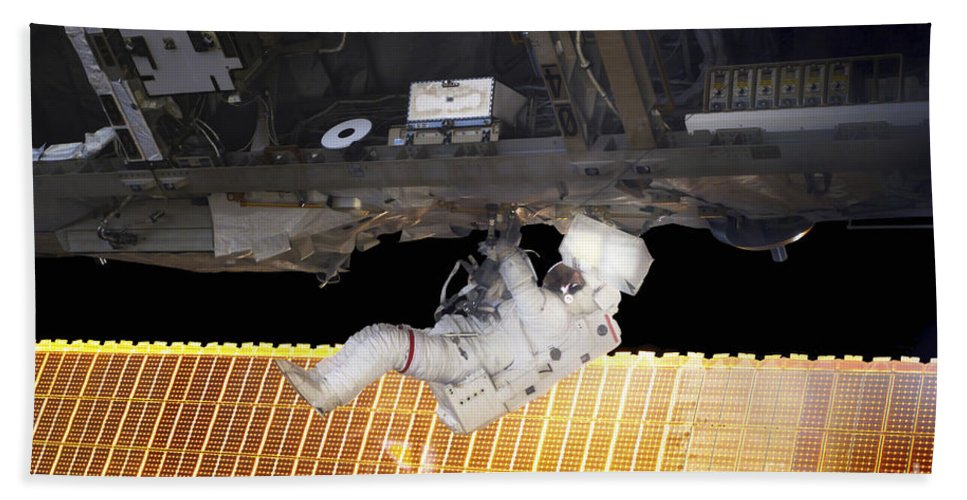 Adults Only Bath Towel featuring the photograph Astronaut Participates In A Spacewalk by Stocktrek Images