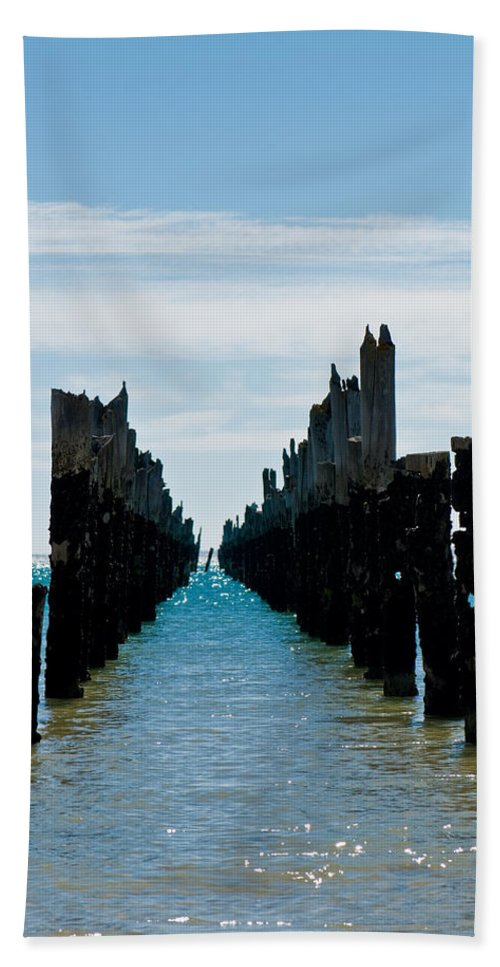 Abstract Bath Sheet featuring the photograph Beautiful Rotten Mooring On A Beach Where Only The Pillars Are L by U Schade