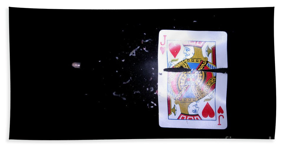 Card Hand Towel featuring the photograph Bullet Hitting A Playing Card by Ted Kinsman