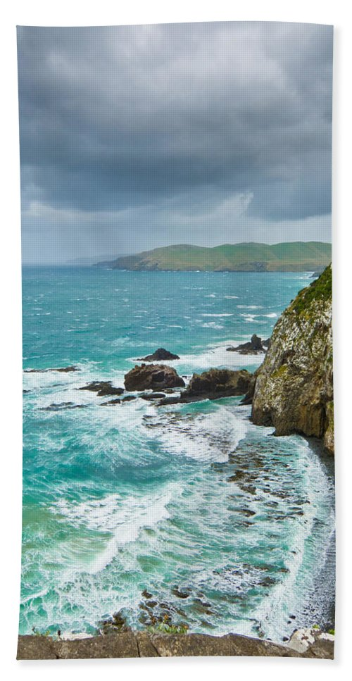 Background Bath Sheet featuring the photograph Cliffs Under Thunder Clouds And Turquoise Ocean by U Schade