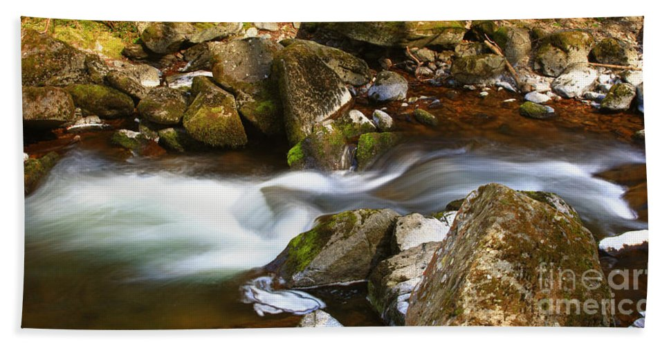 Flowing River Blurred Through Rocks Hand Towel featuring the photograph Flowing River Blurred Through Rocks by Simon Bratt Photography LRPS