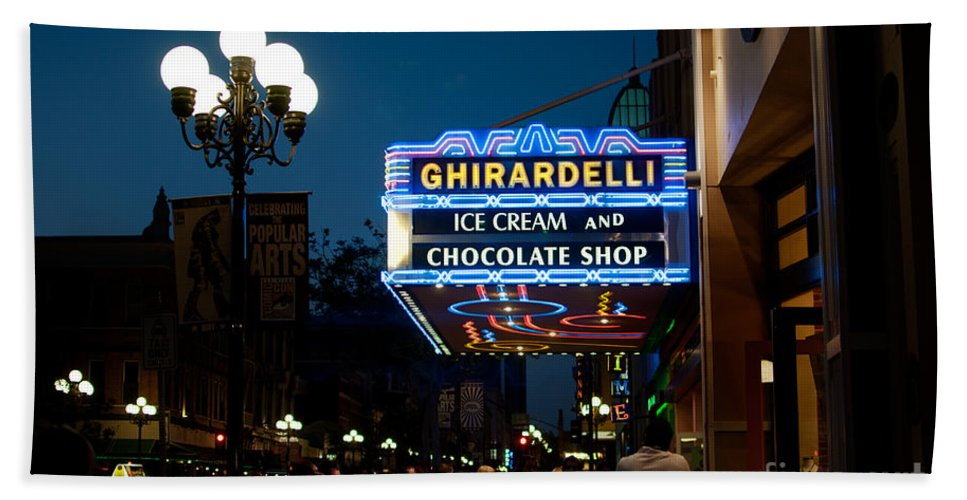 Downtown Hand Towel featuring the digital art Ghirardelli Chocolate Signs At Night by Carol Ailles