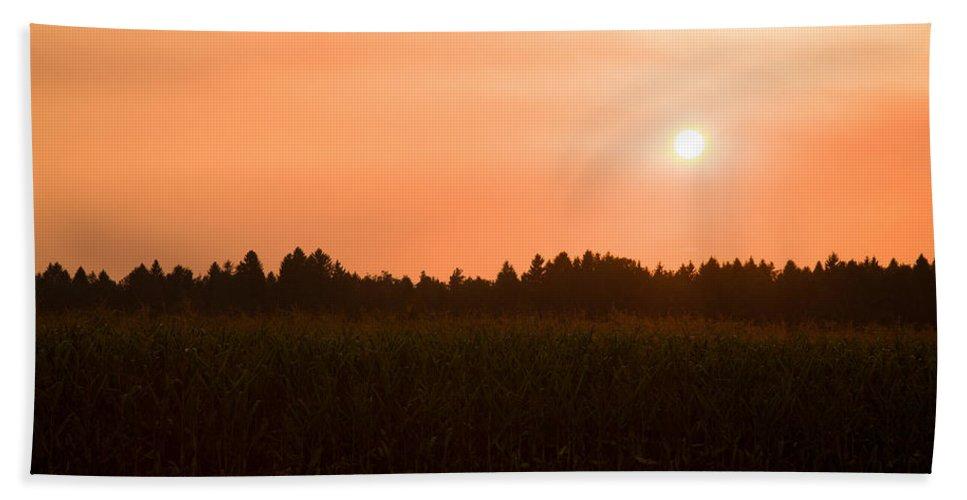 Sunset Bath Sheet featuring the photograph Hazy Summer Sunset by Ian Middleton