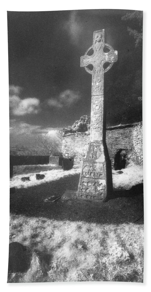 Monument; Stone; Carving; Carved; Shadows; Shadow; Irish; Landscape; Churchyard; Graveyard; Tombstones; Gravestones; Graves; Celtic; Eerie; Atmospheric; Misty; Mist; Solitary Hand Towel featuring the photograph High Cross by Simon Marsden