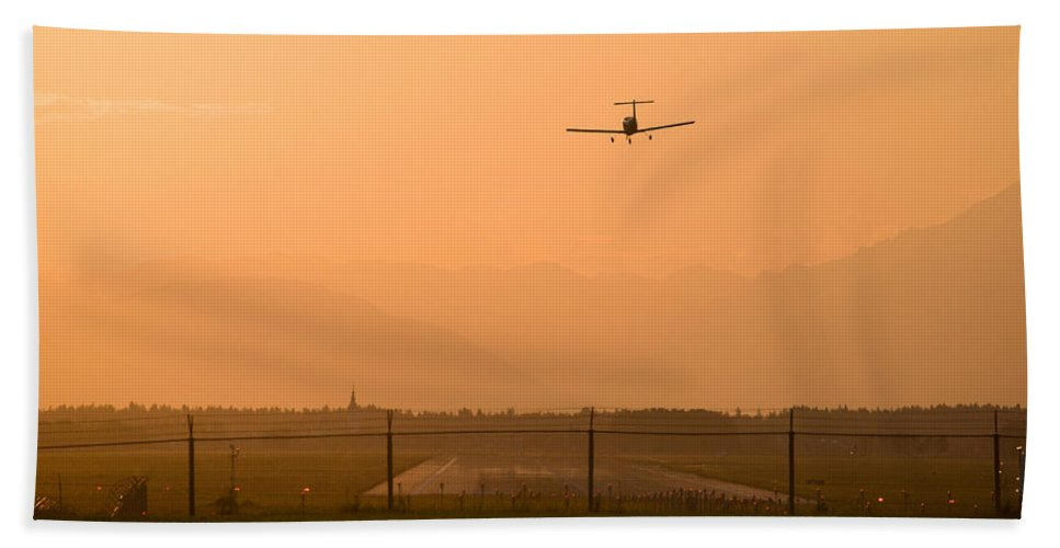 Sunset Bath Sheet featuring the photograph Light Airplane Landing At Sunset On The Summer Solstice by Ian Middleton