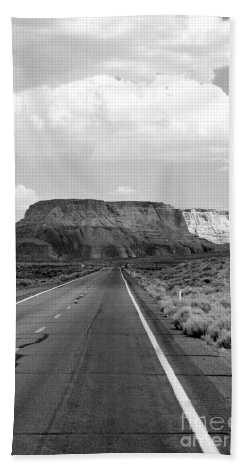 Desert Bath Sheet featuring the photograph Long And Lonely Road by Ellen Heaverlo