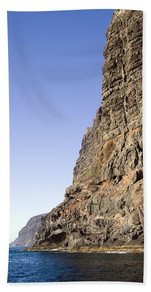 Cliff Hand Towel featuring the photograph Los Gigantes Cliffs by Artur Bogacki