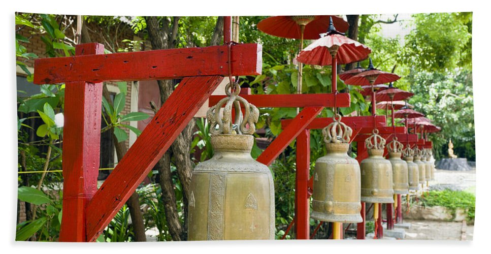 Bell Bath Sheet featuring the photograph Row Of Bells In A Temple Covered By Red Umbrella by U Schade