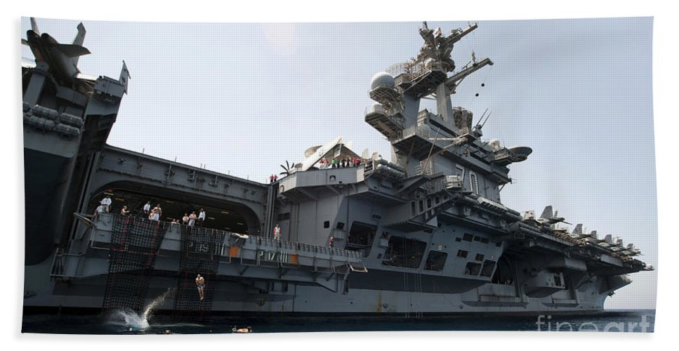 Uss Carl Vinson Hand Towel featuring the photograph Sailors Jump To The Sea During A Swim by Stocktrek Images
