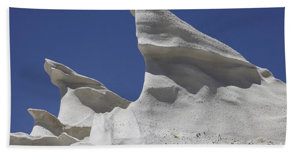 Day Hand Towel featuring the photograph Sarakiniko White Tuff Formations by Richard Roscoe