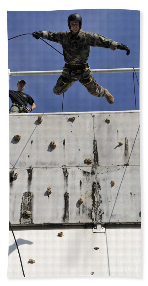 Rappelling Hand Towel featuring the photograph Soldier Rappels Off A Tower While by Stocktrek Images