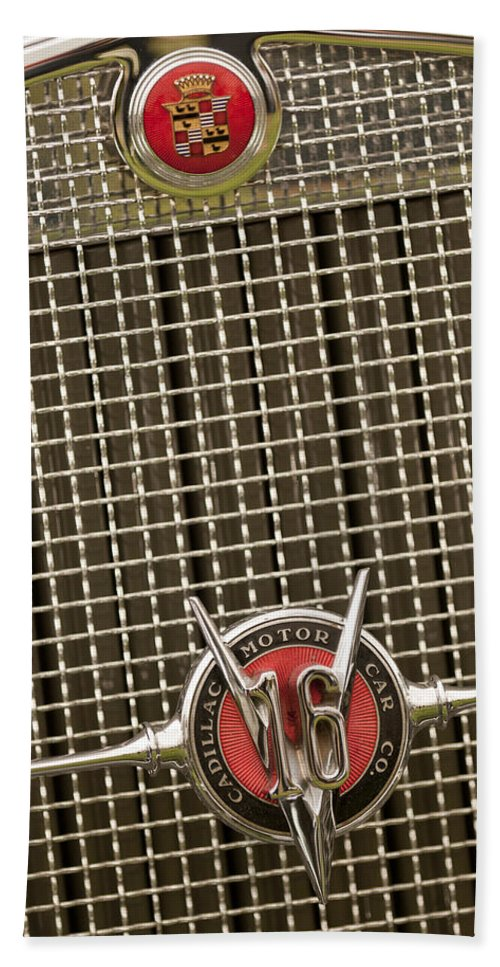 1930 Cadillac 452 Fleetwood Hand Towel featuring the photograph 1930 Cadillac 452 Fleetwood Grille Emblem by Jill Reger