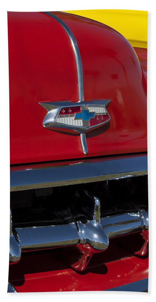1954 Chevrolet Convertible Hand Towel featuring the photograph 1954 Chevrolet Convertible Hood Emblem by Jill Reger
