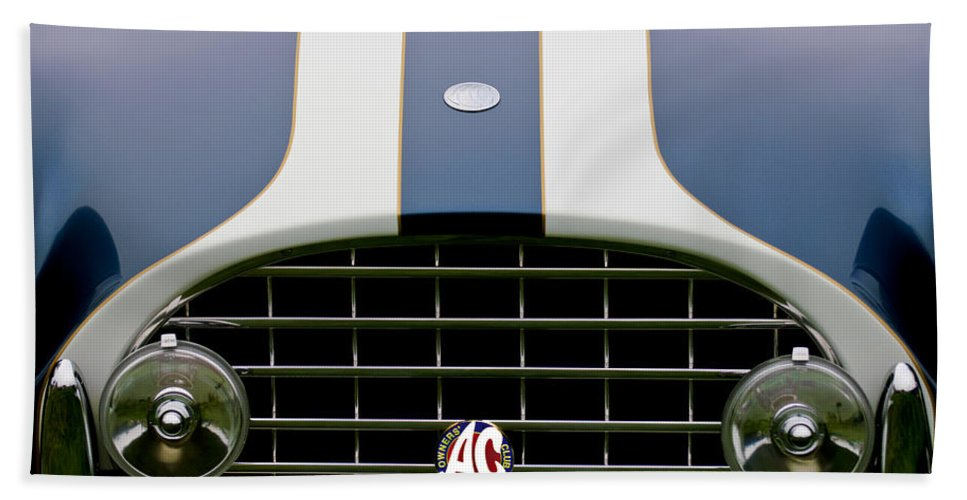 1960 Ac Ace Roadster Bath Sheet featuring the photograph 1960 Ac Ace Roadster Grille Emblem by Jill Reger