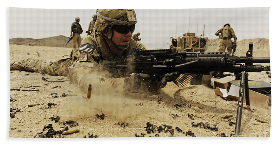 Army Hand Towel featuring the photograph A Soldier Firing His Mk-48 Machine Gun by Stocktrek Images