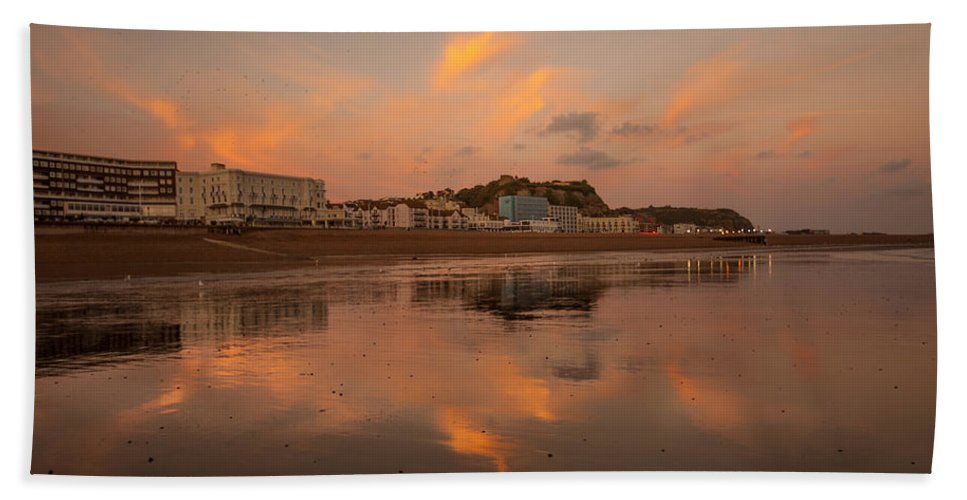 Beach Hand Towel featuring the photograph Hastings Sunset by Dawn OConnor