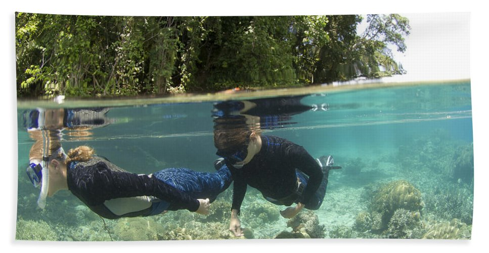 Kimbe Bay Bath Sheet featuring the photograph Split Level View Of Snorkeller by Steve Jones