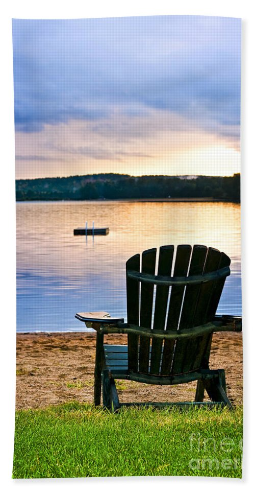 Lake Hand Towel featuring the photograph Wooden Chair At Sunset On Beach by Elena Elisseeva