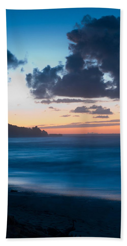 Beach Bath Sheet featuring the photograph A Beach During Sunset With Glowing Sky by U Schade
