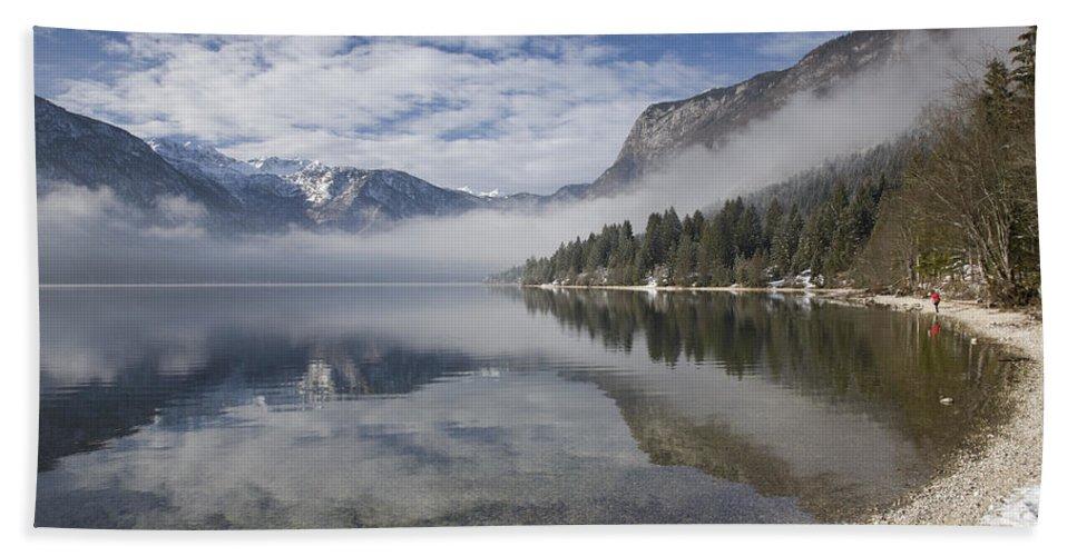 Bohinj Hand Towel featuring the photograph mist burning off Lake Bohinj by Ian Middleton