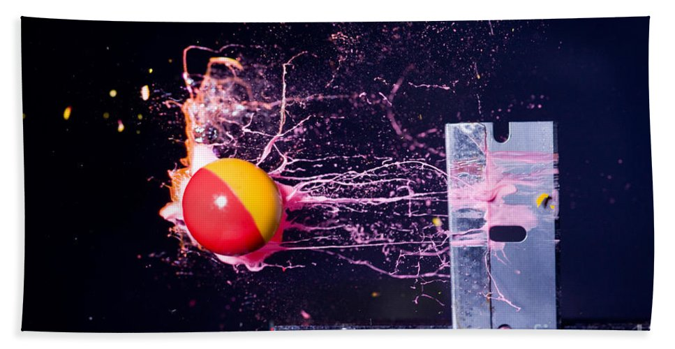 Paintball Hand Towel featuring the photograph Paintball Shot At Razor Blade by Ted Kinsman