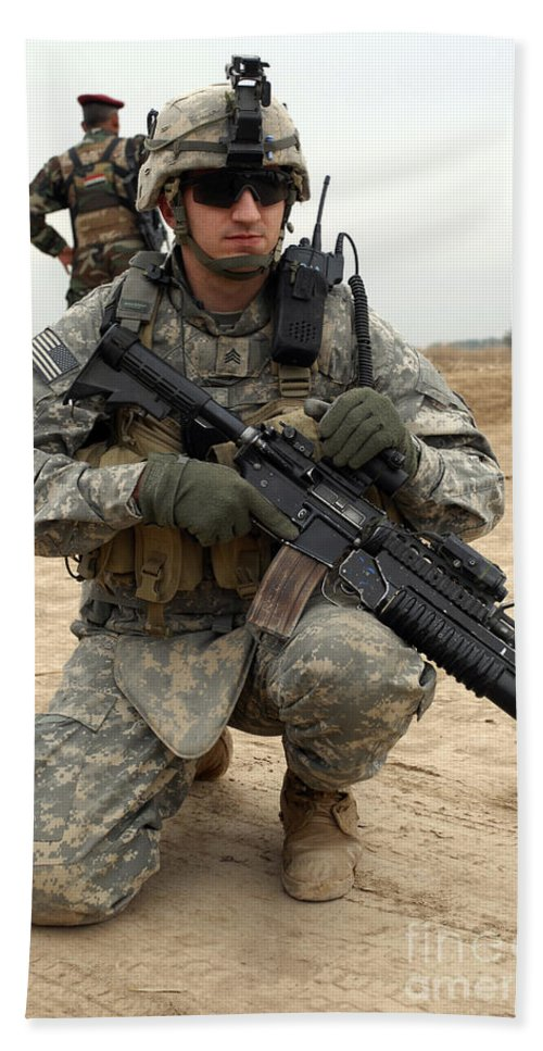 Sergeant Hand Towel featuring the photograph U.s. Army Sergeant Provides Security by Stocktrek Images