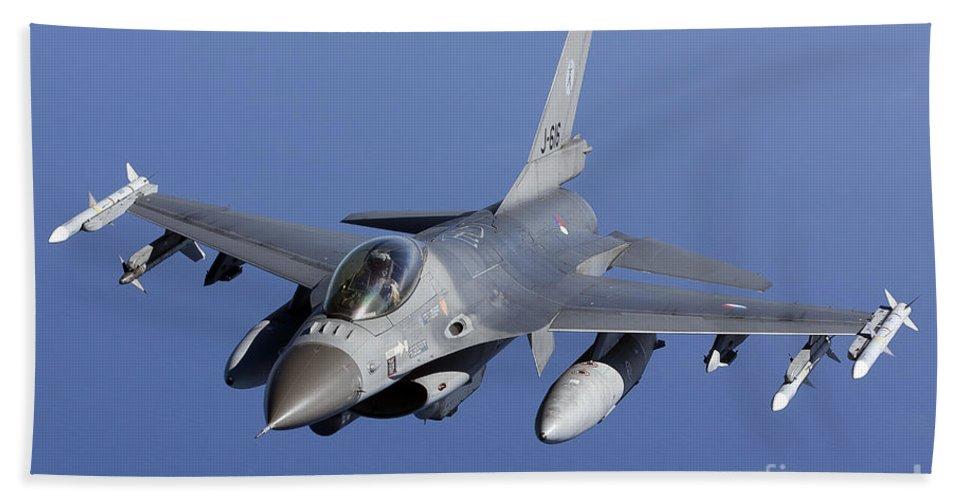 Aim-120 Bath Sheet featuring the photograph Dutch F-16am During A Combat Air Patrol by Gert Kromhout
