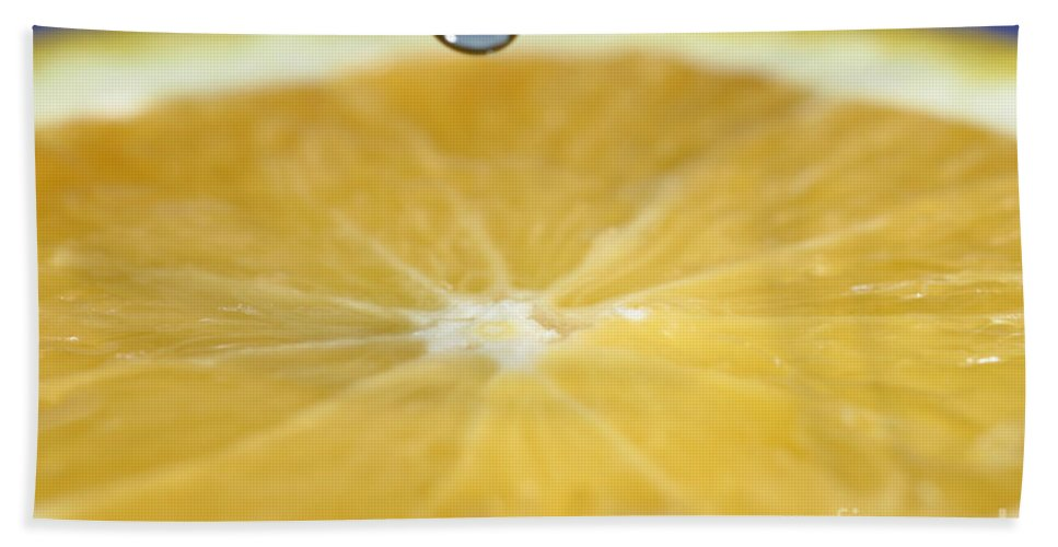 Water Hand Towel featuring the photograph Drip Over An Orange by Ted Kinsman