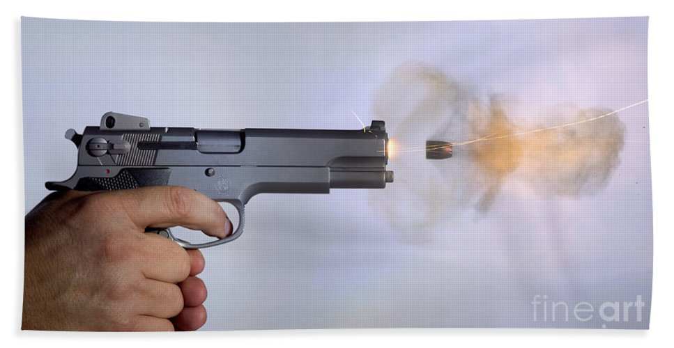 Bullet Hand Towel featuring the photograph Handgun And .45 Caliber Bullet by Ted Kinsman