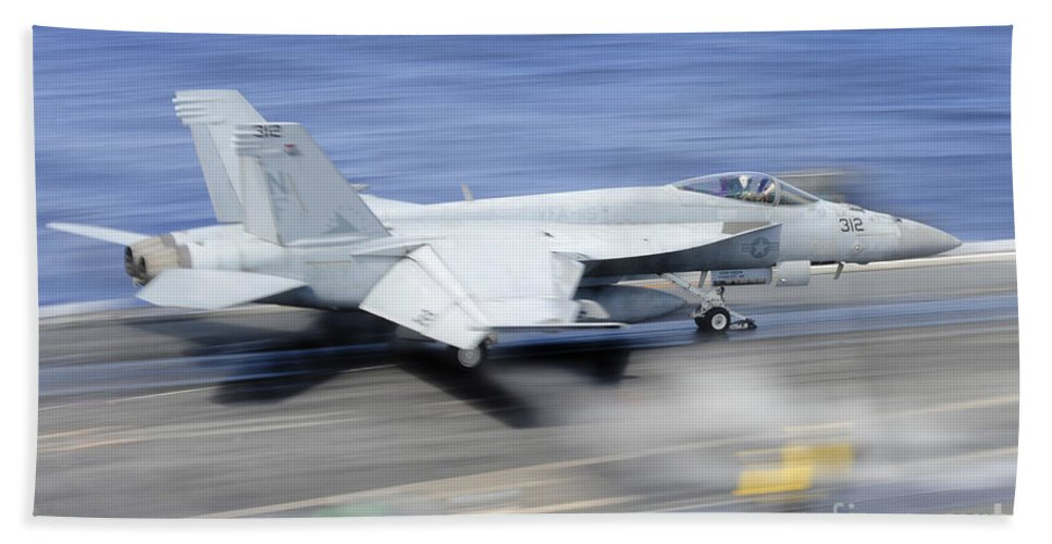 Uss George Washington Hand Towel featuring the photograph An Fa-18e Super Hornet Launches by Stocktrek Images