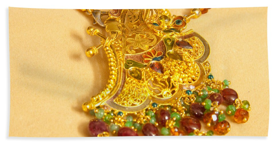 Jewel Bath Sheet featuring the photograph A Beautiful Intricately Carved Gold Pendant Hanging From A Semi-precious Stone Chain by Ashish Agarwal