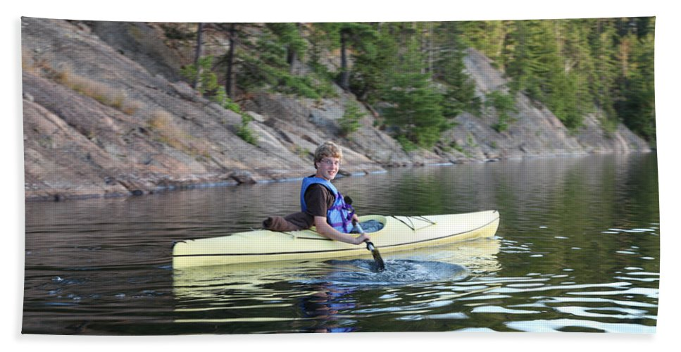 Boy Hand Towel featuring the photograph A Boy Kayaking by Ted Kinsman