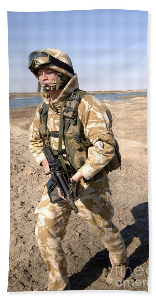 Foreign Military Bath Sheet featuring the photograph A British Army Soldier On Patrol by Andrew Chittock
