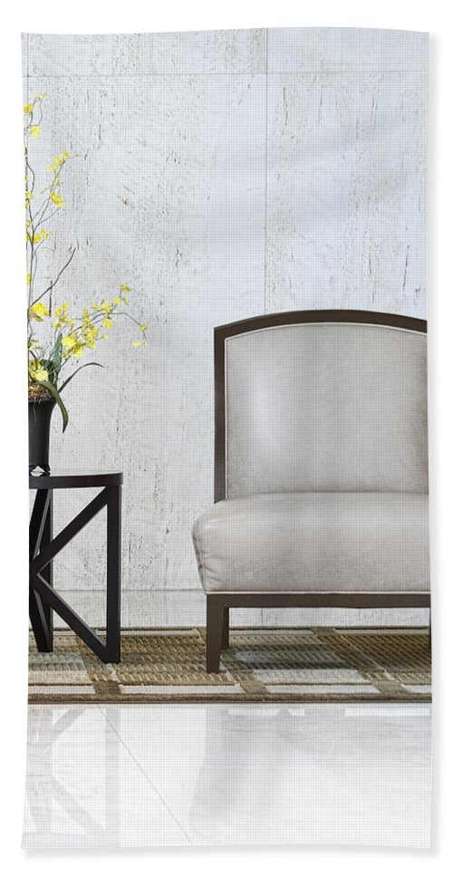Table Hand Towel featuring the photograph A Chair And A Table With A Plant by Rudy Umans
