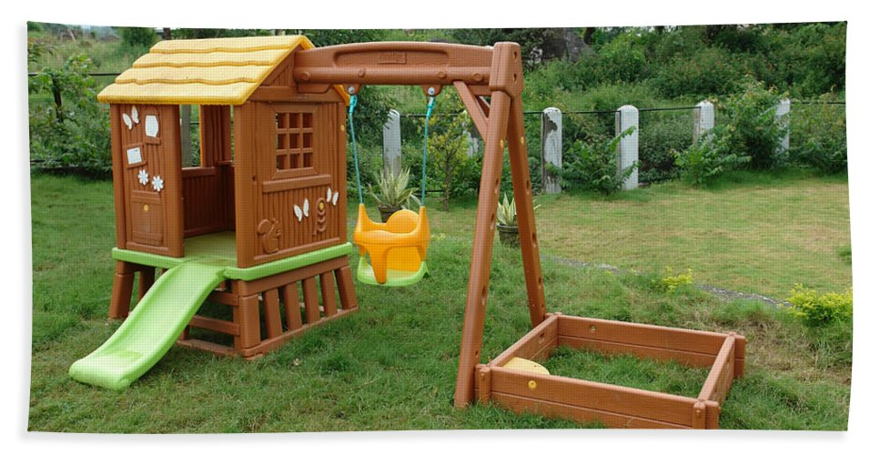 Child Bath Sheet featuring the photograph A Childs Playing Equipment In A Green Location by Ashish Agarwal