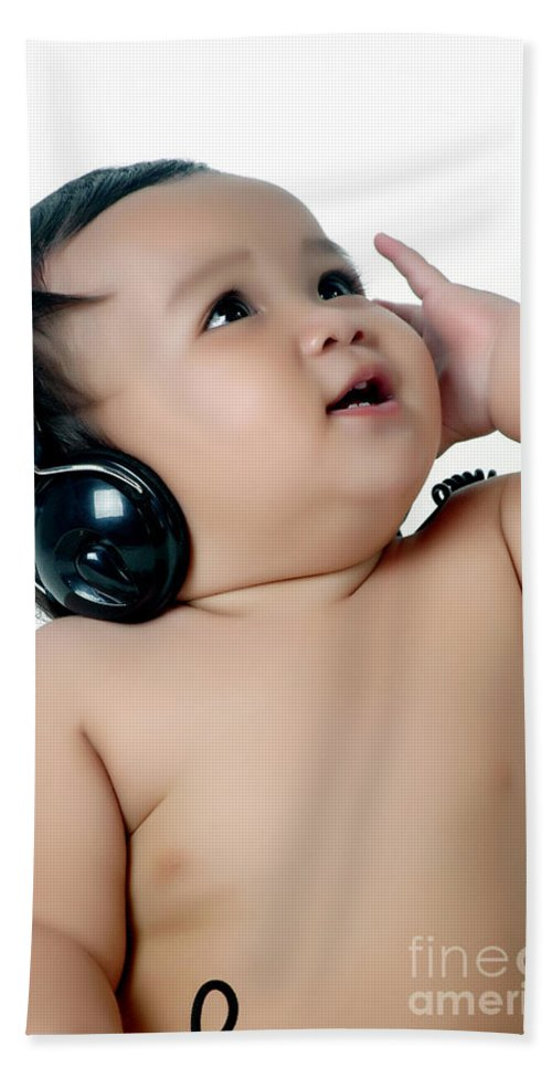 Baby Hand Towel featuring the photograph A Chubby Little Girl Listen To Music With Headphones by Antoni Halim