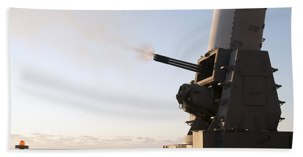 Exercise Bold Alligator Hand Towel featuring the photograph A Close-in Weapons System Fires A Burst by Stocktrek Images