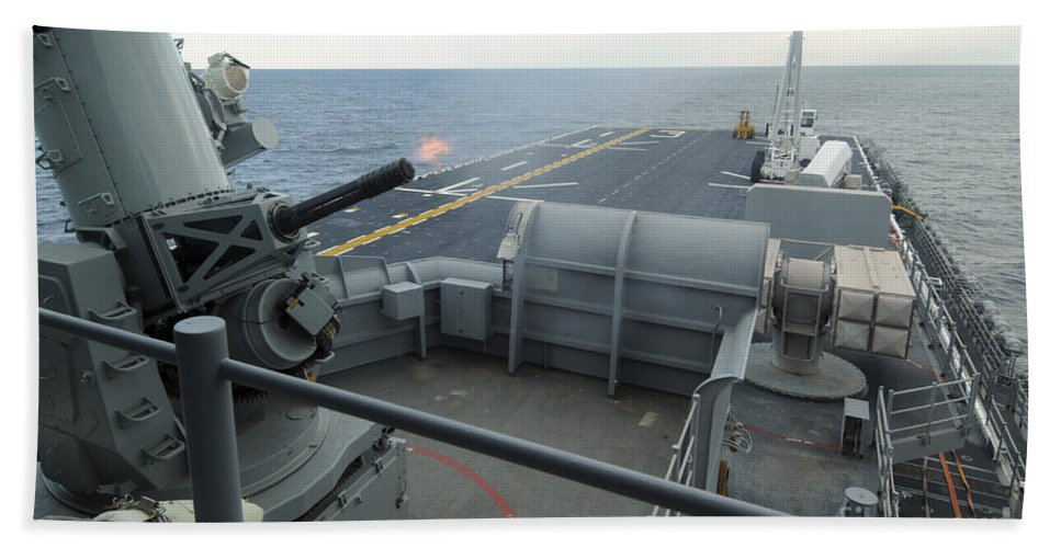 Phalanx Hand Towel featuring the photograph A Close-in Weapons System Fires Aboard by Stocktrek Images