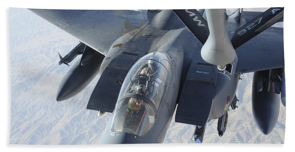 Kc-135 Stratotanker Hand Towel featuring the photograph A Kc-135 Stratotanker Refuels An F-15e by Stocktrek Images