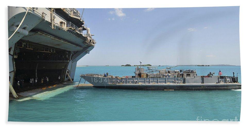 Amphibious Assault Ships Bath Sheet featuring the photograph A Landing Craft Utility Approaches by Stocktrek Images