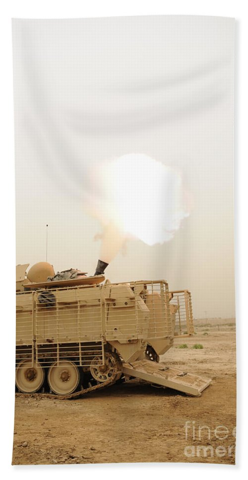 Iraq Bath Sheet featuring the photograph A M120 Mortar System Is Fired by Stocktrek Images