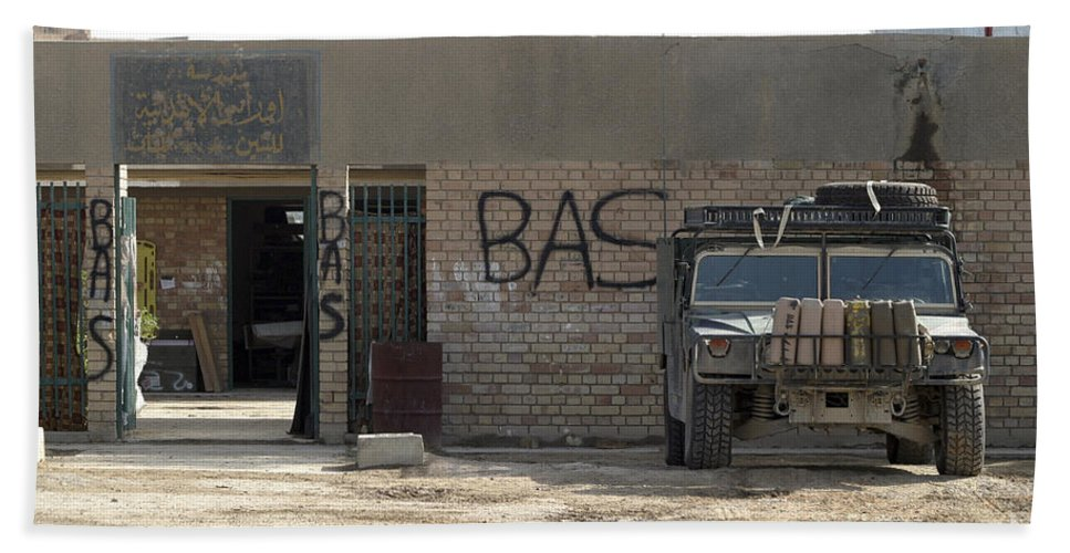 Operation Iraqi Freedom Bath Sheet featuring the photograph A M998 Humvee Parked Outside An by Stocktrek Images