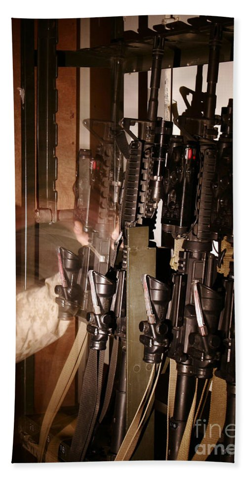 5.56mm Bath Towel featuring the photograph A Marine Pulls An M-4 Rifle by Stocktrek Images
