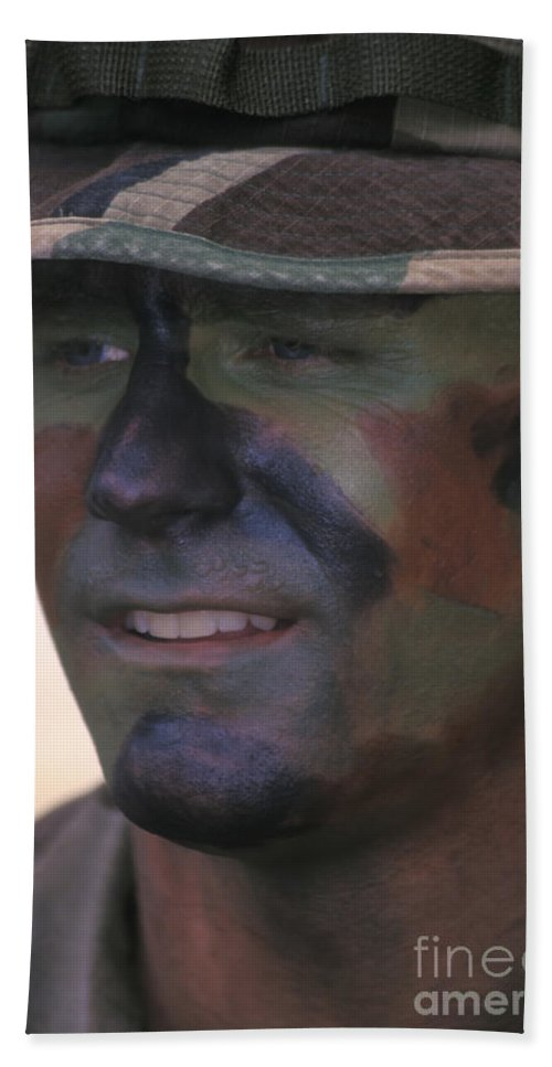A Navy Seal Wearing Face Camouflage Bath Towel