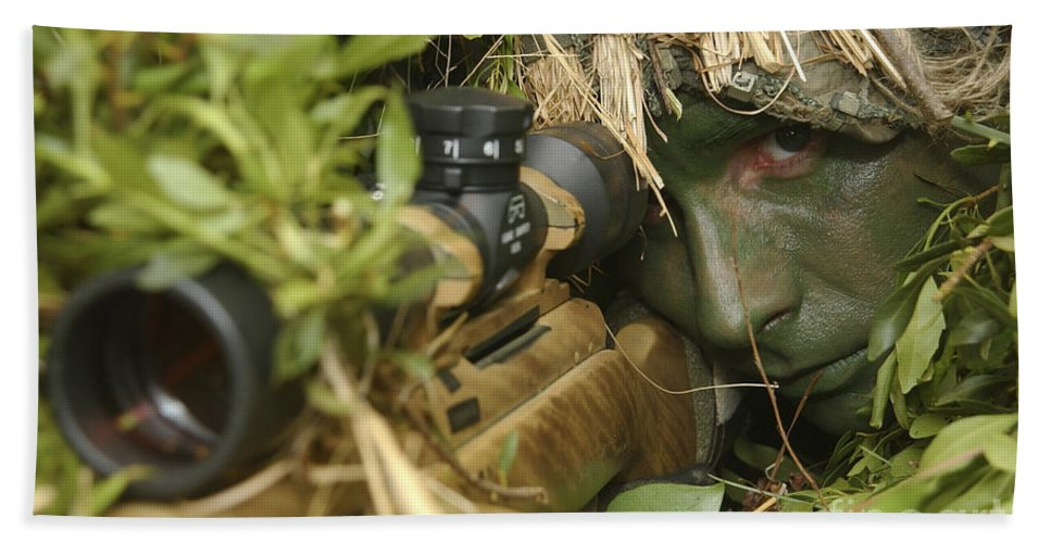 Grass Bath Sheet featuring the photograph A Sniper Dressed In A Ghillie Suit by Stocktrek Images