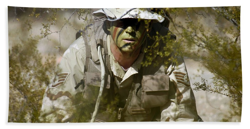 Horizontal Bath Sheet featuring the photograph A Soldier Practices Evasion Maneuvers by Stocktrek Images