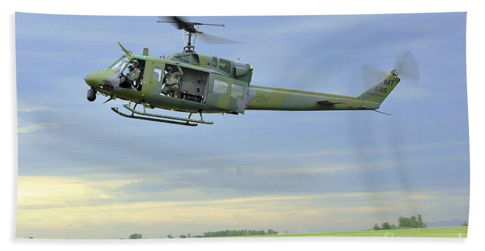 Minot Air Force Base Hand Towel featuring the photograph A Uh-1n Huey Helicopter Prepares by Stocktrek Images
