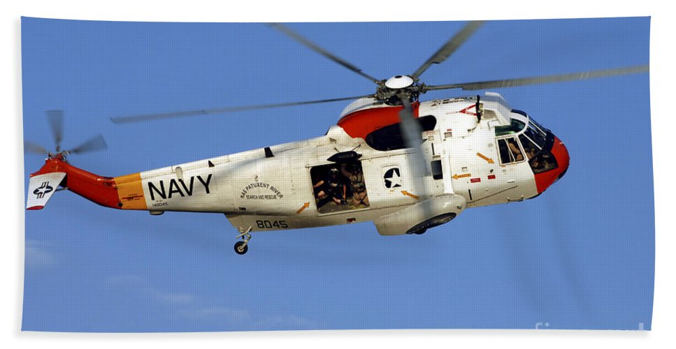 Aircraft Hand Towel featuring the photograph A Uh-3h Sea King Helicopter Flies by Stocktrek Images
