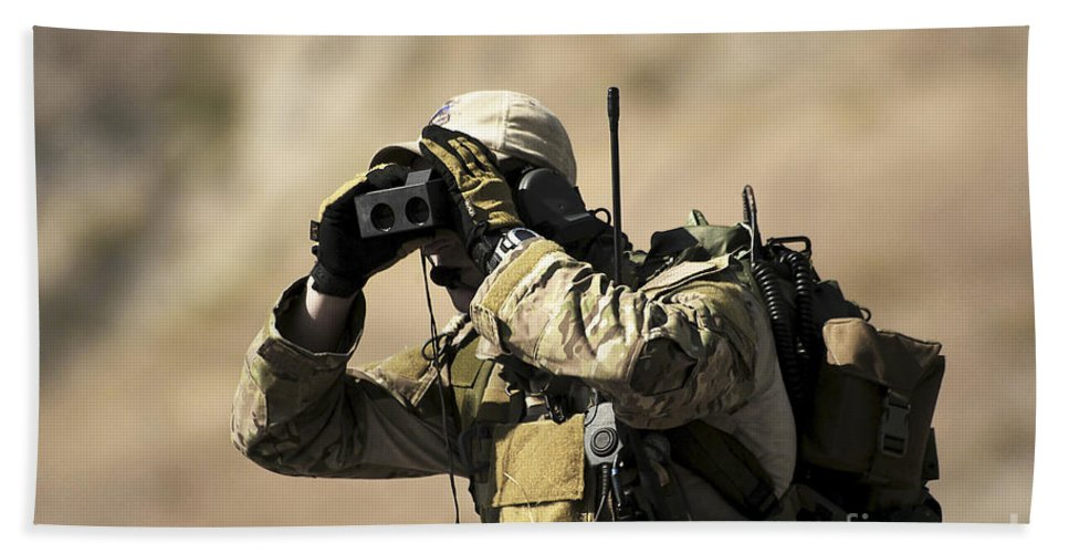 Rangefinder Hand Towel featuring the photograph A U.s. Air Force Combat Controller Uses by Stocktrek Images